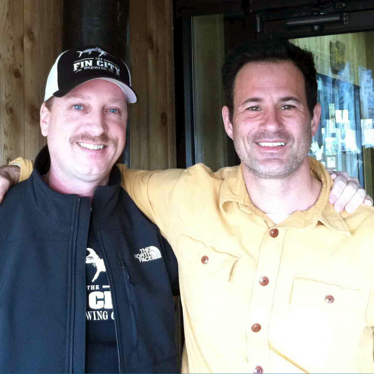 two male owners of fin city brewing company